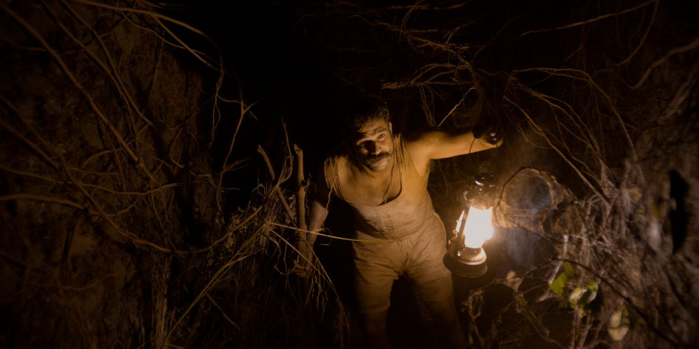 Tumbbad - Soham Shah holding the lantern.