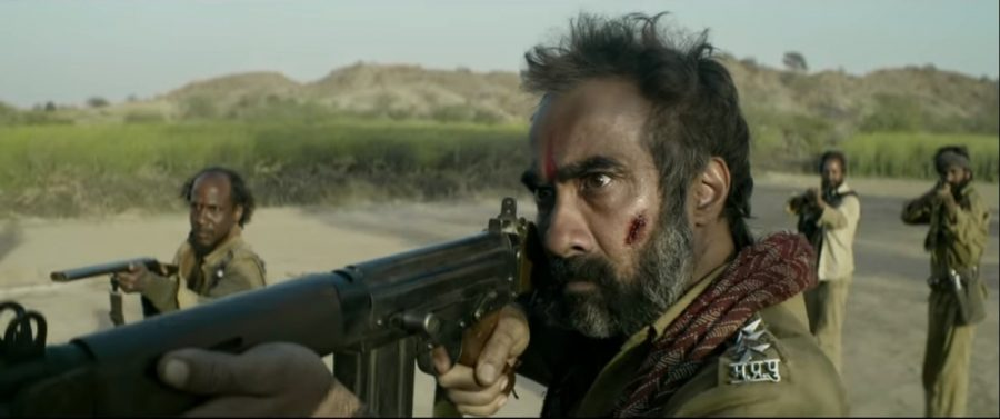 Ranvir Shorey as dacoit holding a rifle in Sonchiriya 2019