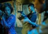 Veronica Ngo pointing gun to hunchmen in Vietnam film - FURIE