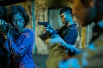 Veronica Ngo pointing gun to hunchmen in Vietnam film - FURIE