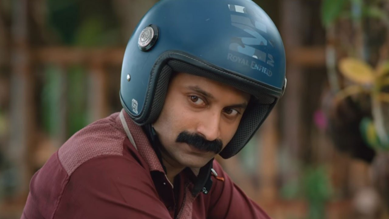 Fahadh Faasil wearing helmet on the bike in Kumbalangi Nights Indian Movies 2019