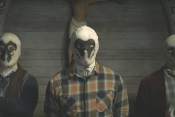 The image is from Watchmen TV series by HBO that has three men in mask who are declared as outlaws