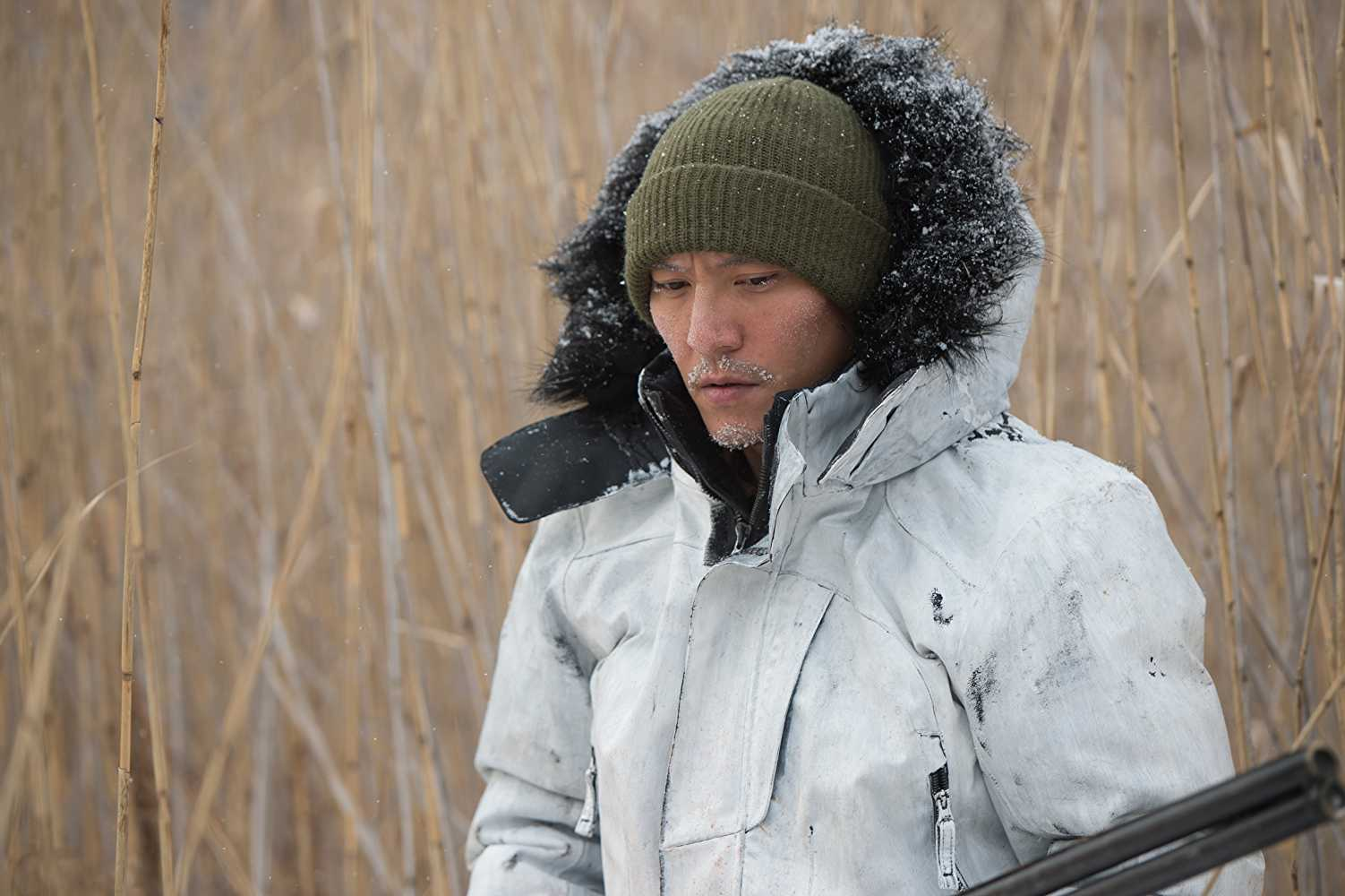 Chang Chen as Wang in Savage